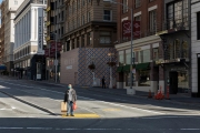 A man stands in the middle of the street in downtown San Francisco, CA, on March 20, 2020, All the retail stores are closed following an order from the governor.  California residents were ordered to stay home to slow the spread of the coronavirus as part of a lockdown effort.