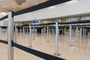 The security checkpoint sits empty of travelers at the San Francisco International airport on April 7, 2019. The COVID-19 pandemic has reduced air traffic tremendously.
