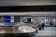 A traveler walks through the baggage claim section that sits empty of travelers at the San Francisco International airport on April 7, 2019. The COVID-19 pandemic has reduced air traffic tremendously.