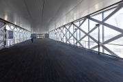 A corridor empty of travelers at the San Francisco International airport on April 7, 2019. The COVID-19 pandemic has reduced air traffic tremendously.