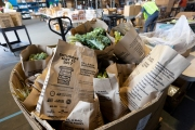 "Bags of food at the Alameda Food Bank distribution center in Alameda, CA, on April 15, 2019. The food was distributed later through a drive-through to people in need following the loss of their jobs due to the ""shelter-in-place"" order to limit the spread of the coronavirus SARS-CoV-2."