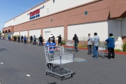 Shoppers at a local Costco store in Hayward, CA, on April 15, 2020. Long lines with a distance of 6 feet between each person is now the norm  to limit the spread of the coronavirus SARS-CoV-2.