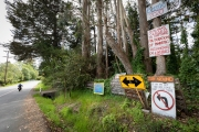 Signs at the entrance to the reclusive town of Bolinas, CA, on April 20, 2020, ask visitors to stay away because of the coronavirus pandemic.