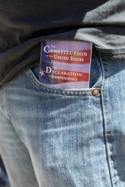A protester with the US constitution on his pocket  in front of the California State Capitol in Sacramento, CA, on May 1, 2020.