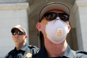 A police officer wearing a mask  blocks the access to the California State Capitol in Sacramento, CA, on May 1, 2020.