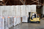 A  sighted worker drives his forklift  by 1,000-pound rolls of toilet paper and boxes of finished products inside the Sirkin Center in San Leandro, CA, on May 11, 2020.