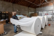 A  sighted worker prepares 1,000-pound rolls of toilet paper at the production line of toilet paper packets inside the Sirkin Center in San Leandro, CA, on May 11, 2020.