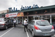 Waiters or carhops taking orders from customers in their cars  at the Mel's  Drive-In restaurant in San Francisco, CA, on May 12, 2020.Like in the 1950's, Mel's Drive-In restaurant in San Francisco is now offering carhop service so customers stay safe while still feeling like they get the experience of eating out during the shelter-in-place order due to the coronavirus pandemic.