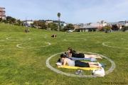 People lay on the grass inside circles drawn to encourage  social distancing at Dolores Park in San Francisco, CA, on  May 21, 2020. This effort marks the city's latest effort to get back to some sort of normalcy following the long shelter-in-place order while trying to keep the risks of infection from the coronavirus to the minimum.