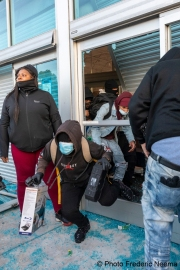 Looters stealing goods after they broke into the local Best Buy store in Emeryville , CA, on May 30, 2020.