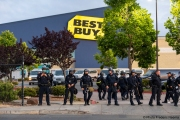 Policemen in front of the local Best Buy store in Emeryville , CA, on May 30, 2020, after it was broken into by looters.