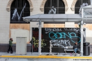 A storefront protected bay plywood  and some graffiti in Oakland, CA, on May 30, 2020