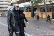 A couple with face masks walks by a local Chase bank with its storefront protected by plywood  in Oakland, CA, on May 30, 2020,