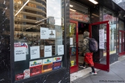 A man enters a store  in Oakland, CA, on May 30, 2020, which has its front filled with words in  support of George Floyd in Minneapolis, MN, who passed away while pleading with arresting officers that he couldn't breathe as one of the officers was shown on video kneeling on his neck.
