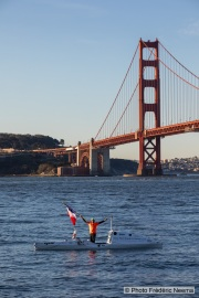Kayaker Cyril Derreumaux waves a French flag during training in the San Francisco Bay on February 25, 2021, with the Golden gate Bridge in the background.France-born American entrepreneur Cyril Derreumaux (44) will leave at the end of May 2021 for a 70-day solo and unsupported sea kayak Pacific crossing from California to Hawaii.