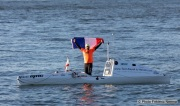 Kayaker Cyril Derreumaux waves a French flag during training in the San Francisco Bay on February 25, 2021.France-born American entrepreneur Cyril Derreumaux (44) will leave at the end of May 2021 for a 70-day solo and unsupported sea kayak Pacific crossing from California to Hawaii.